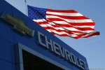 FILE PHOTO OF A CHEVROLET LOGO AND THE U.S. FLAG IN GAITHERSBURG MARYLAND